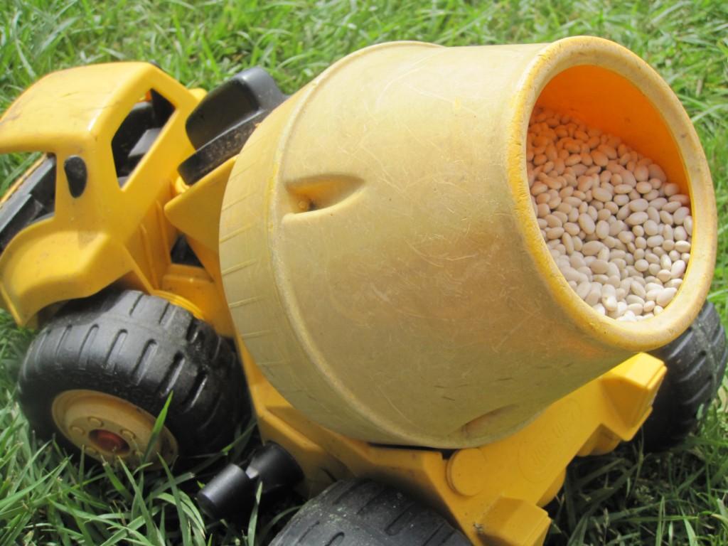 Preschool Outdoors Activities: Fill Trucks with Beans