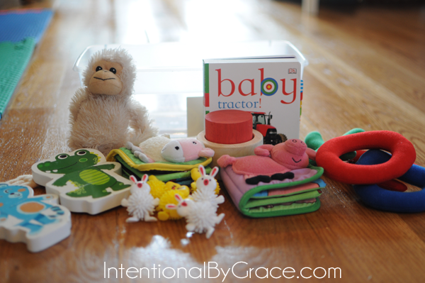 Everything you need to know to create and use busy boxes with your baby! | IntentionalByGrace.com