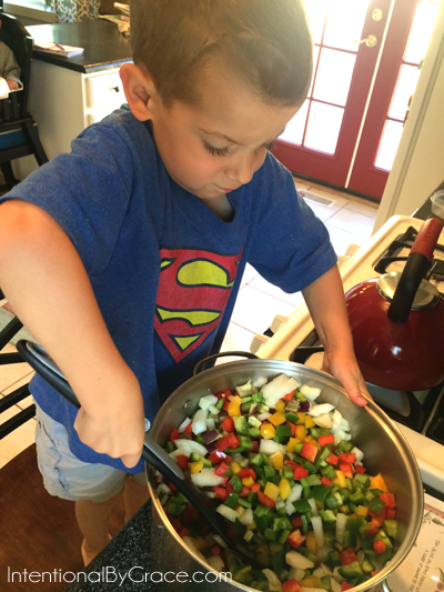 stirring peppers