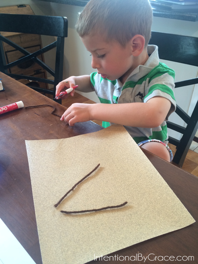 letter a with sandpaper